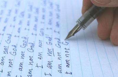 "hand writing the phrase, ""I'm not God."""