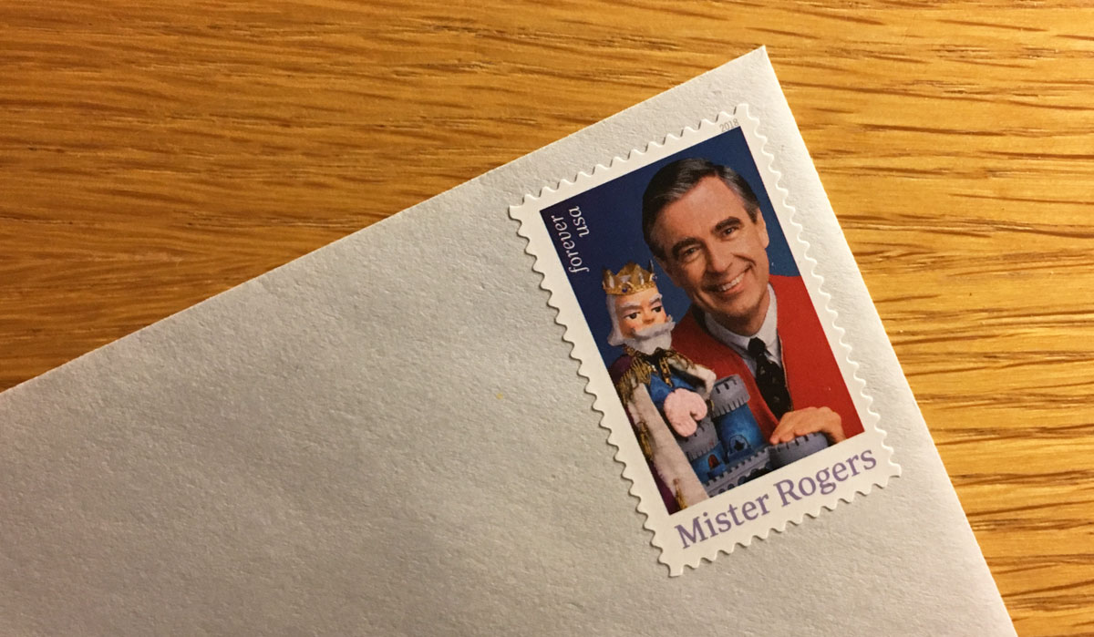 the corner of an envelope with a postage stamp