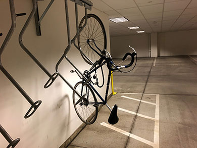 a bicycle parked in a bike rack in a basement