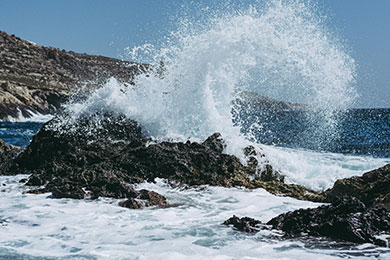 wave crashing on rocks at the seashore